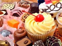 Dolci, muffin e dolci del cioccolato Immagini Stock
