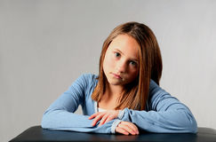 Doleful. Close-up of pretty blonde girl child sitting royalty free stock photos