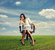 Doleful businesswoman sitting. On the office chair at outdoors stock image