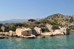 Dolikisthe, antic sink ruins in Turkey. Old antic ruins of Dolikisthe city near a Kekova in Turkey. Sink ruins under sea and in hill royalty free stock photography