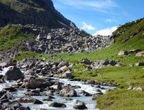 Dolina Karakolska valley in Kyrgyzstan with a stream and snow capped mount Karakol Stock Photo