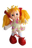 Doll. Toy doll with yellow hair in big red shoes Stock Photo