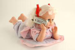 Doll. Is talking with cellular phone Stock Photo