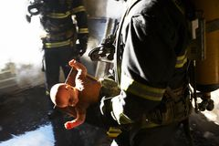 The doll. Fireman picked up the doll. Was destroyed during the fire apartment Stock Image