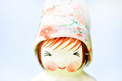 Doll. Smile doll in a garden(ceramic Royalty Free Stock Photo