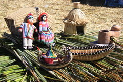 Doll. Handmade products from reeds tartare , which produces plovoucíchostrovů residents of Lake Titicaca Stock Photo