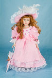 Doll. Big hand made doll on blue background royalty free stock photo