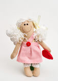 Doll angel with his hands on white background Royalty Free Stock Photography