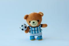 Doll bear play football Stock Image