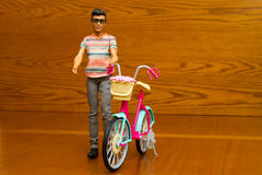 Doll with a bicycle Stock Images
