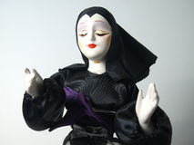 Doll in black habit giving blessing Stock Photos