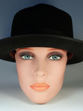 Doll with black hat 2. The head of a shop window doll wears a black hat Royalty Free Stock Images
