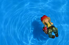 Doll on Blue water Royalty Free Stock Photo