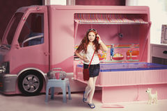 Doll camping, red-haired girl. Standing outside his puppet camping, concept doll house Royalty Free Stock Photography