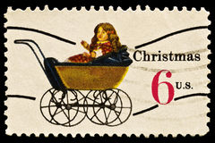 Doll Carriage Christmas Stamp. Doll Carriage was issued in 1970 to celebrate Christmas Stock Images