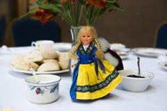 Doll Center Piece. White Doll Tea Center at The Salvation Army, Tacoma Corps, Washington USA stock image