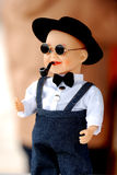 The doll of a chinese boy. A funny plastic cartoon figure of a chinese boy Royalty Free Stock Photo