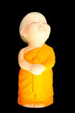 Doll clay baby monk isolated on black background Stock Photos
