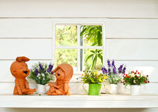 Doll clay and flower in garden Stock Photos