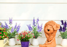 Doll clay and flower in garden Stock Image