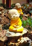 Doll clay monk in ornamental garden Stock Photo