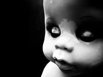 Doll with closed eyes Stock Images