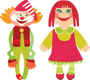 Doll and Clown. Two cute toy - smiling doll and jolly clown Royalty Free Stock Image