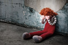 Doll Crying. In dirty floor., Dark tone Royalty Free Stock Image