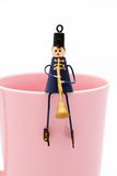 Doll on cup. Collection of small toy figurine, soldier marching band Stock Images