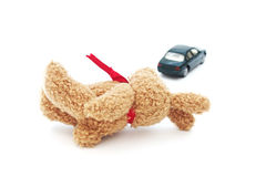 Doll and defocused car on white background Stock Image
