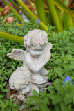 Doll. S, carved plaster for garden Stock Images