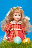 Doll with easter eggs Stock Photo