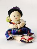 Doll from Ecuador. Woman carrying her baby on her back dressed in blue ornamented dress and red slipper like shoes Royalty Free Stock Image