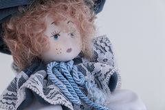 Doll. Expressionless doll with red hair Royalty Free Stock Photography