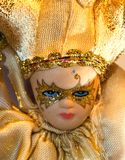 Doll Face In Gold Stock Photos