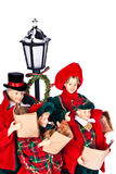 Doll family singing Christmas carols. Winter scene with a white background royalty free stock images