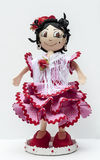 Doll with flamenco dress. Vertical surrounded by white background Stock Images