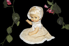 Doll with flowers. Royalty Free Stock Photo