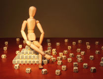 Doll and game dices Royalty Free Stock Photography