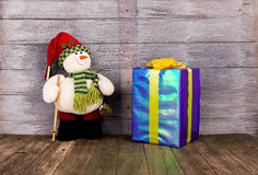 Doll with gift box Stock Photography