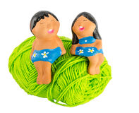 Doll on green yarn Royalty Free Stock Images