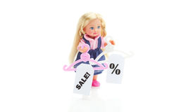 Doll and hanger with a sale Royalty Free Stock Photos