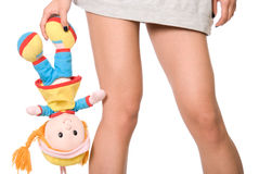 Doll hangs on a hand at girl Stock Photos