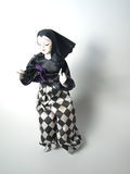Doll in harlequin patterned trousers Stock Photography