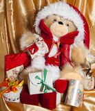 Doll with hat of santa claus and gifts Royalty Free Stock Photo