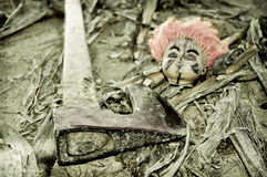 Doll head and axe Royalty Free Stock Photography