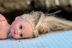 Doll. Head with blond hair Royalty Free Stock Photo
