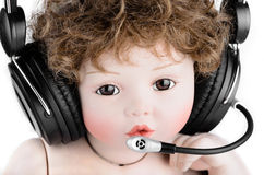 Doll with a headset Royalty Free Stock Images