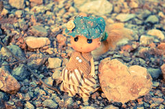 Doll and heart. A lovely doll standing wild grass alone with a heart Stock Photography