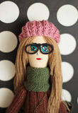 Doll. Hipster doll in pink  hat and glasses Royalty Free Stock Image